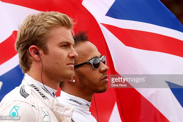 Lewis Hamilton of Great Britain and Mercedes GP and Nico Rosberg of Germany and Mercedes GP stand for the national anthem before the Formula One...