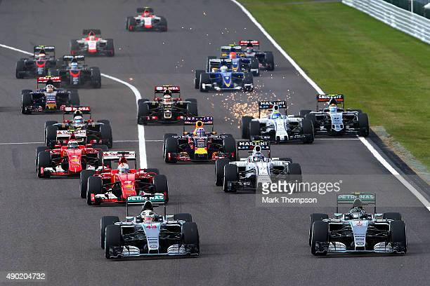 Lewis Hamilton of Great Britain and Mercedes GP and Nico Rosberg of Germany and Mercedes GP race down to the first corner during the Formula One...