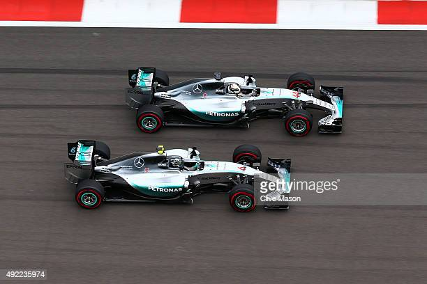 Lewis Hamilton of Great Britain and Mercedes GP and Nico Rosberg of Germany and Mercedes GP race into the first corner during the Formula One Grand...