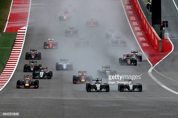 Lewis Hamilton of Great Britain and Mercedes GP and Nico Rosberg of Germany and Mercedes GP drive side by side ahead of Daniel Ricciardo of Australia...