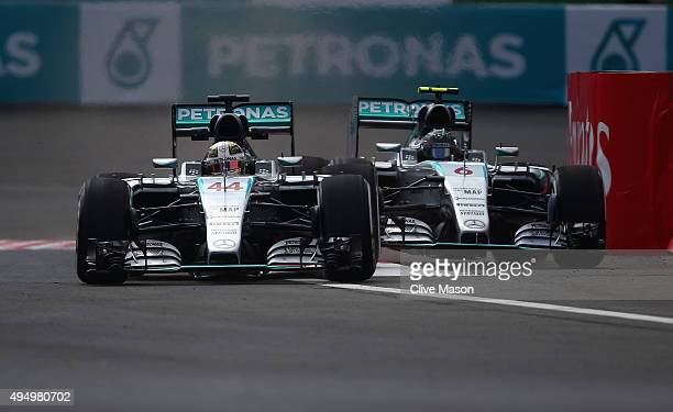 Lewis Hamilton of Great Britain and Mercedes GP and Nico Rosberg of Germany and Mercedes GP drive side by side during practice for the Formula One...
