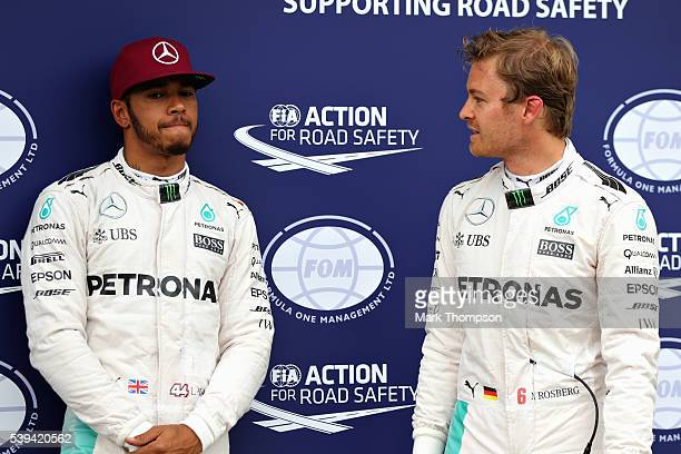 Lewis Hamilton of Great Britain and Mercedes GP and Nico Rosberg of Germany and Mercedes GP talk in parc ferme during qualifying for the Canadian...
