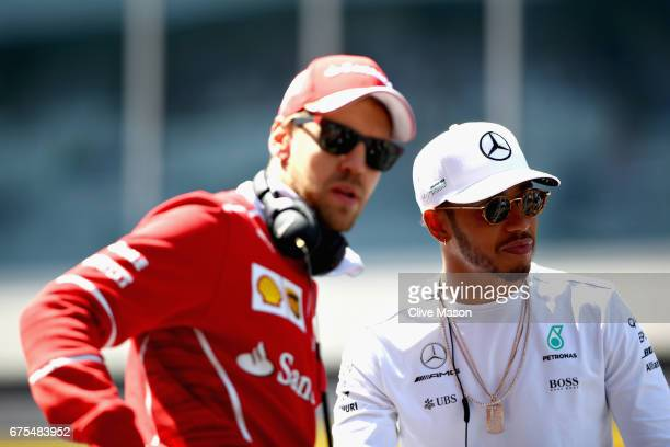 Lewis Hamilton of Great Britain and Mercedes GP and Sebastian Vettel of Germany and Ferrari on the drivers parade during the Formula One Grand Prix...