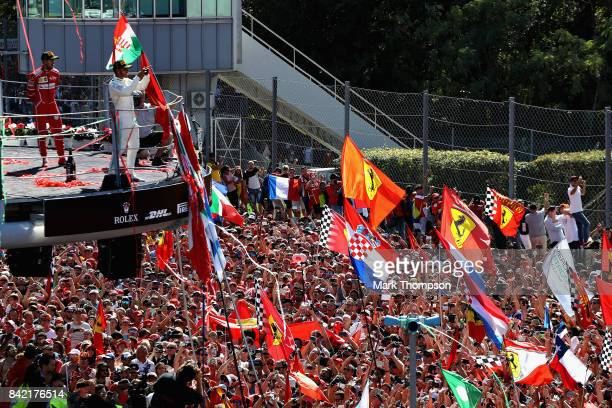Lewis Hamilton of Great Britain and Mercedes GP and Sebastian Vettel of Germany and Ferrari celebrate on the podium during the Formula One Grand Prix...