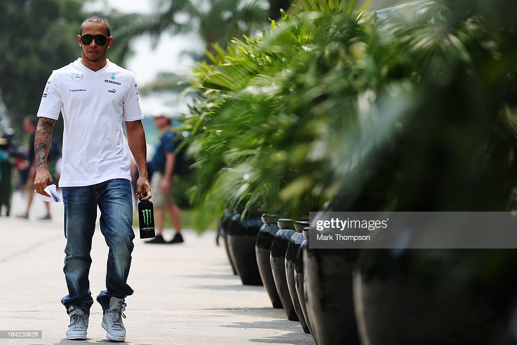 <a gi-track='captionPersonalityLinkClicked' href=/galleries/search?phrase=Lewis+Hamilton+-+Racecar+Driver&family=editorial&specificpeople=586983 ng-click='$event.stopPropagation()'>Lewis Hamilton</a> of Great Britain and Mercedes GP arrives in the paddock during previews to the Malaysian Formula One Grand Prix at the Sepang Circuit on March 21, 2013 in Kuala Lumpur, Malaysia.