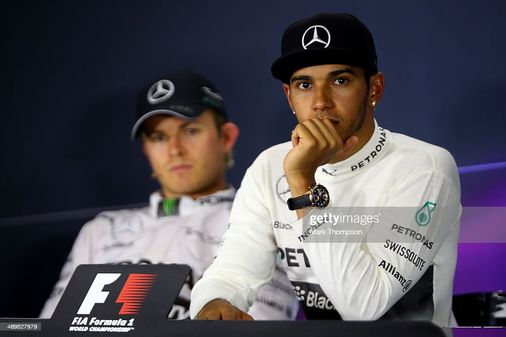 Lewis Hamilton of Great Britain and Mercedes GP attends a press conference with Nico Rosberg of Germany and Mercedes GP after the Spanish Formula One Grand Prix at Circuit de Catalunya on May 11, 2014 in Montmelo, Spain.