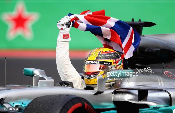 Lewis Hamilton of Great Britain and Mercedes GP celebrates after winning his fourth F1 World Drivers Championship after the Formula One Grand Prix of...