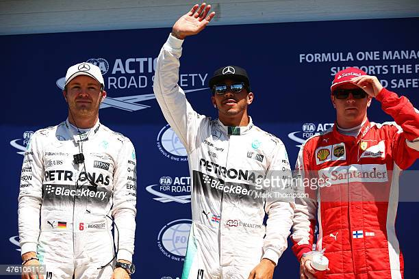 Lewis Hamilton of Great Britain and Mercedes GP celebrates after securing poles position whilst second placed Nico Rosberg of Germany and Mercedes GP...