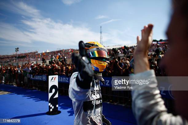 Lewis Hamilton of Great Britain and Mercedes GP celebrates after winning the Hungarian Formula One Grand Prix at Hungaroring on July 28 2013 in...