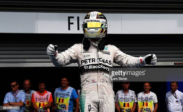 Lewis Hamilton of Great Britain and Mercedes GP celebrates after winning the Formula One Grand Prix of Belgium at Circuit de SpaFrancorchamps on...