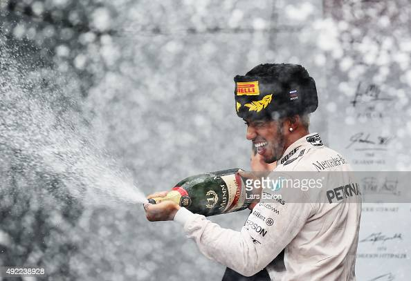 Lewis Hamilton of Great Britain and Mercedes GP celebrates after winning the Formula One Grand Prix of Russia at Sochi Autodrom on October 11 2015 in...