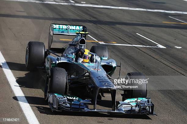 Lewis Hamilton of Great Britain and Mercedes GP celebrates as he crosses the finish line to win the Hungarian Formula One Grand Prix at Hungaroring...