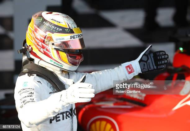 Lewis Hamilton of Great Britain and Mercedes GP celebrates finishing in second place in parc ferme during the Australian Formula One Grand Prix at...