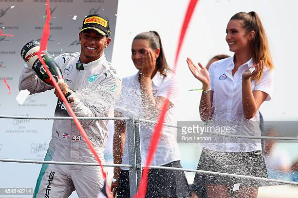 Lewis Hamilton of Great Britain and Mercedes GP celebrates following his victory during the F1 Grand Prix of Italy at Autodromo di Monza on September...