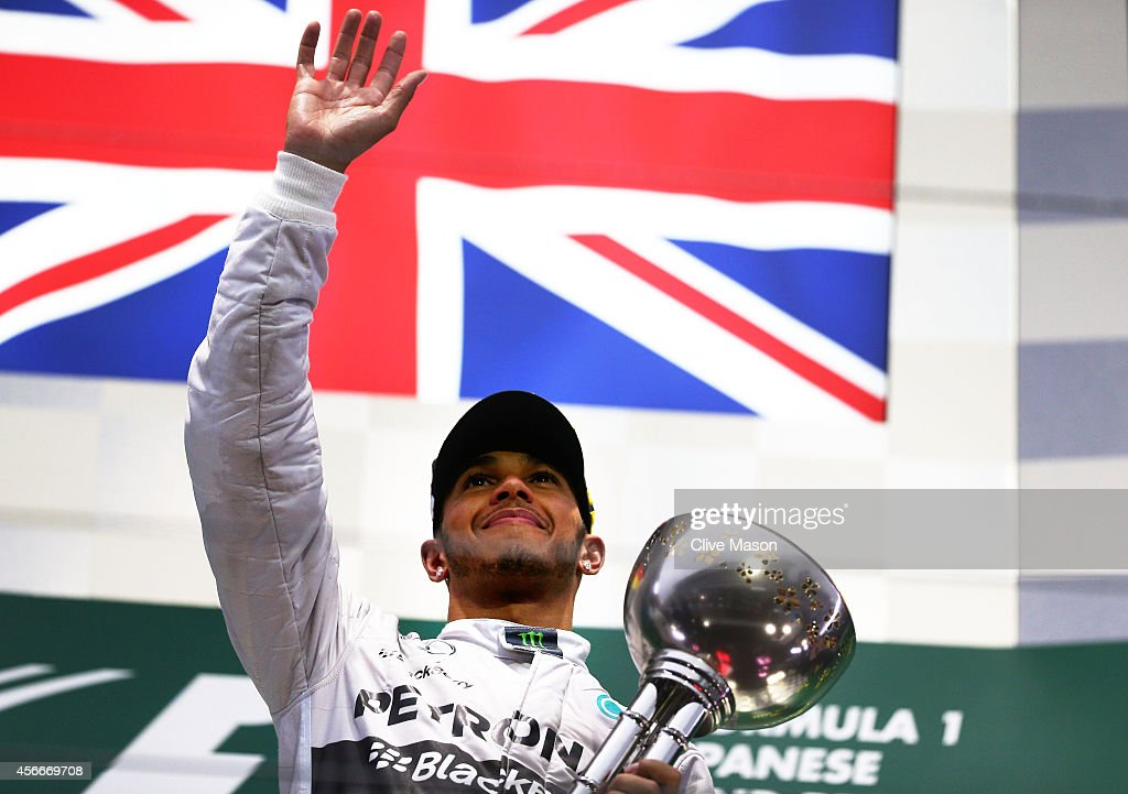 Lewis Hamilton of Great Britain and Mercedes GP celebrates following his victory during the Japanese Formula One Grand Prix at Suzuka Circuit on...