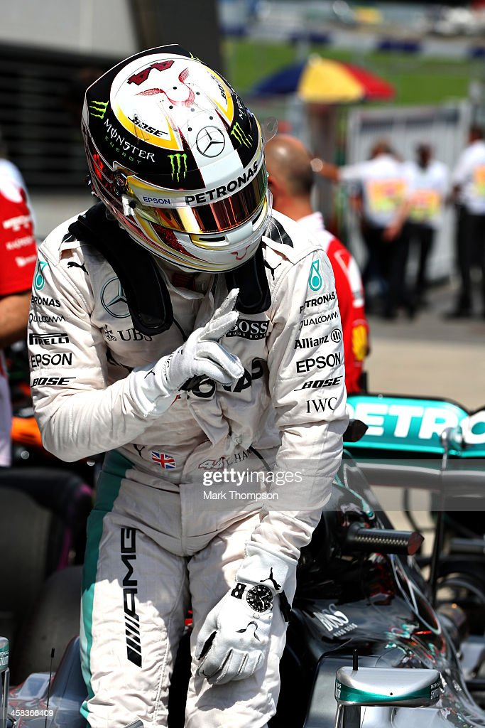 Lewis Hamilton of Great Britain and Mercedes GP celebrates his pole position in parc ferme during qualifying for the Formula One Grand Prix of...