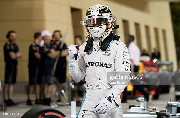 Lewis Hamilton of Great Britain and Mercedes GP celebrates his pole position in parc ferme during qualifying for the Bahrain Formula One Grand Prix...
