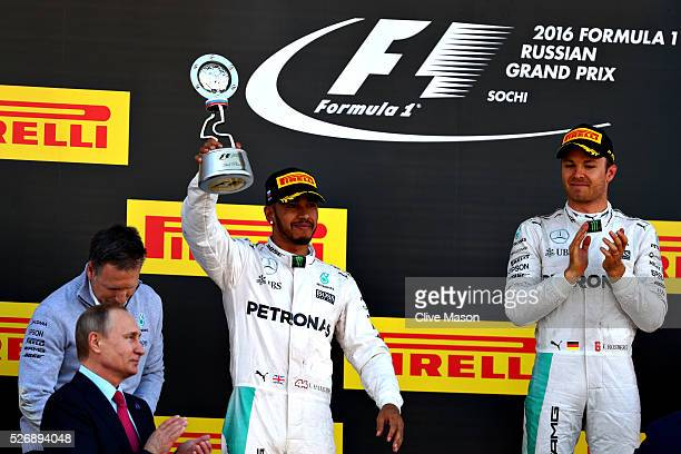 Lewis Hamilton of Great Britain and Mercedes GP celebrates his second placed finish on the podium Nico Rosberg of Germany and Mercedes GP and Russian...