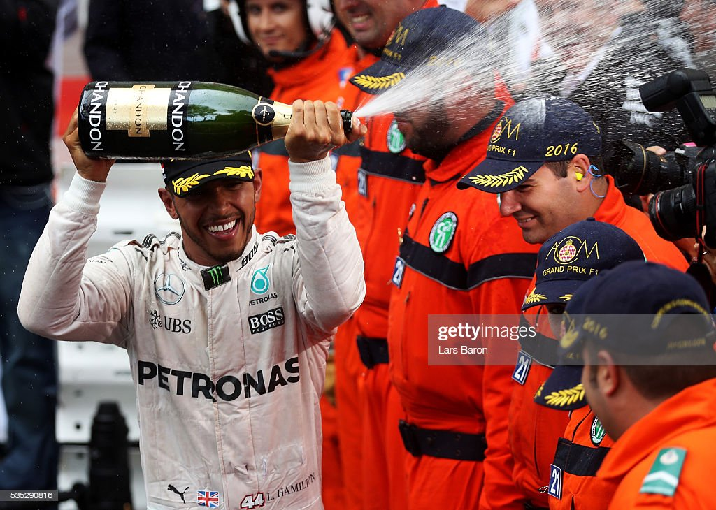 <a gi-track='captionPersonalityLinkClicked' href=/galleries/search?phrase=Lewis+Hamilton+-+Racecar+Driver&family=editorial&specificpeople=586983 ng-click='$event.stopPropagation()'>Lewis Hamilton</a> of Great Britain and Mercedes GP celebrates his win at the podium during the Monaco Formula One Grand Prix at Circuit de Monaco on May 29, 2016 in Monte-Carlo, Monaco.
