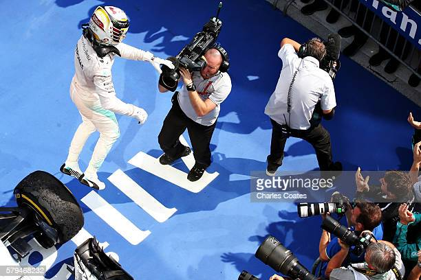 Lewis Hamilton of Great Britain and Mercedes GP celebrates his win in parc ferme during the Formula One Grand Prix of Hungary at Hungaroring on July...