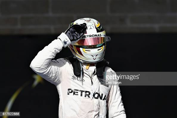 Lewis Hamilton of Great Britain and Mercedes GP celebrates his win in parc ferme during the United States Formula One Grand Prix at Circuit of The...