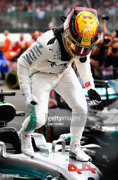 Lewis Hamilton of Great Britain and Mercedes GP celebrates his win in parc ferme during the Formula One Grand Prix of Great Britain at Silverstone on...