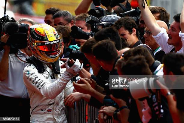 Lewis Hamilton of Great Britain and Mercedes GP celebrates his win in parc ferme during the Formula One Grand Prix of Belgium at Circuit de...