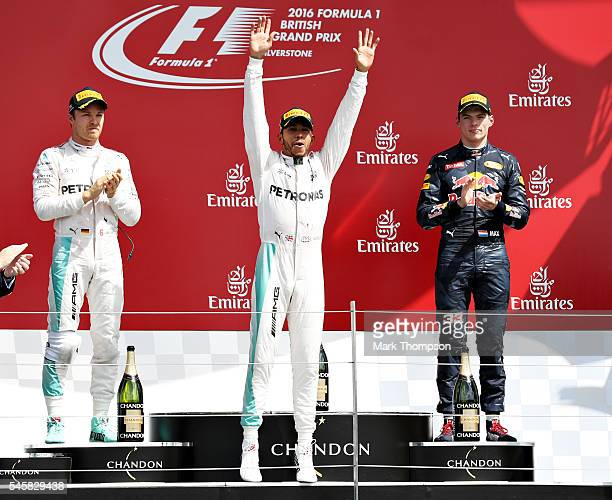 Lewis Hamilton of Great Britain and Mercedes GP celebrates his win on the podium with Nico Rosberg of Germany and Mercedes GP and Max Verstappen of...