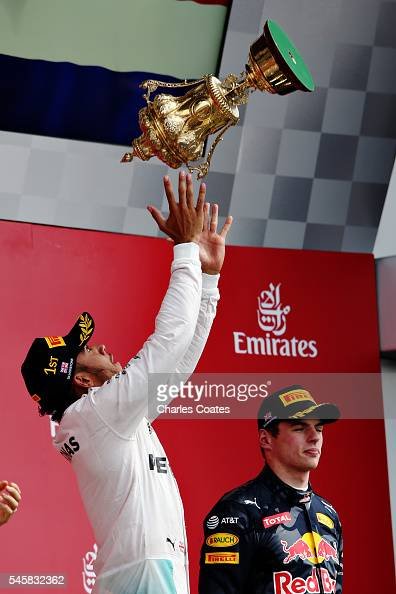 Lewis Hamilton of Great Britain and Mercedes GP celebrates his win on the podium during the Formula One Grand Prix of Great Britain at Silverstone on...