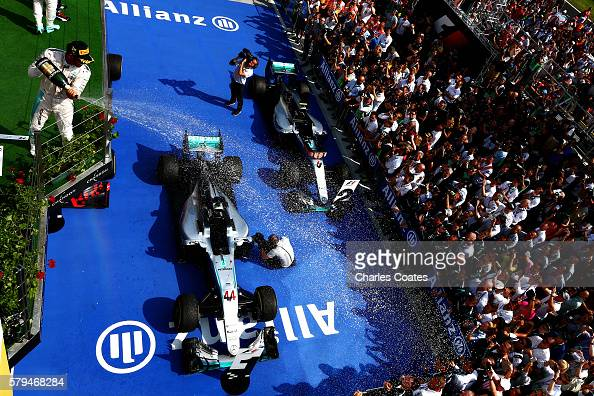 Lewis Hamilton of Great Britain and Mercedes GP celebrates his win on the podium during the Formula One Grand Prix of Hungary at Hungaroring on July...