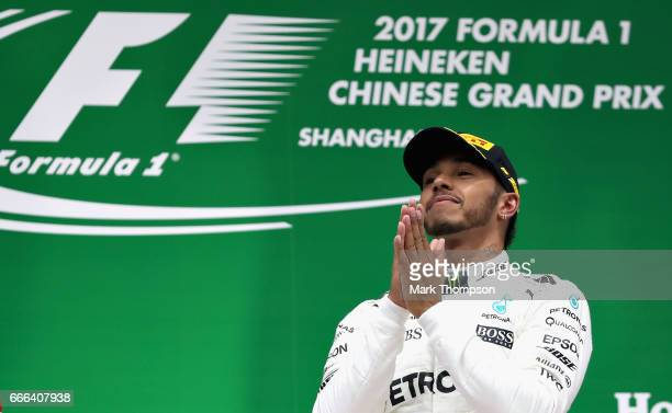 Lewis Hamilton of Great Britain and Mercedes GP celebrates his win on the podium during the Formula One Grand Prix of China at Shanghai International...