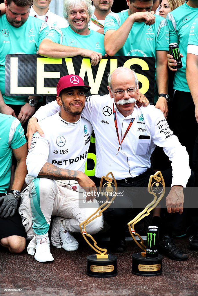 <a gi-track='captionPersonalityLinkClicked' href=/galleries/search?phrase=Lewis+Hamilton&family=editorial&specificpeople=586983 ng-click='$event.stopPropagation()'>Lewis Hamilton</a> of Great Britain and Mercedes GP celebrates his win with <a gi-track='captionPersonalityLinkClicked' href=/galleries/search?phrase=Dieter+Zetsche&family=editorial&specificpeople=241297 ng-click='$event.stopPropagation()'>Dieter Zetsche</a>, Chairman of the Board of Directors of Daimler AG and Head of Mercedes-Benz Cars and his team during the Monaco Formula One Grand Prix at Circuit de Monaco on May 29, 2016 in Monte-Carlo, Monaco.