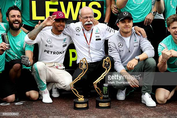 Lewis Hamilton of Great Britain and Mercedes GP celebrates his win with Dieter Zetsche Chairman of the Board of Directors of Daimler AG and Head of...