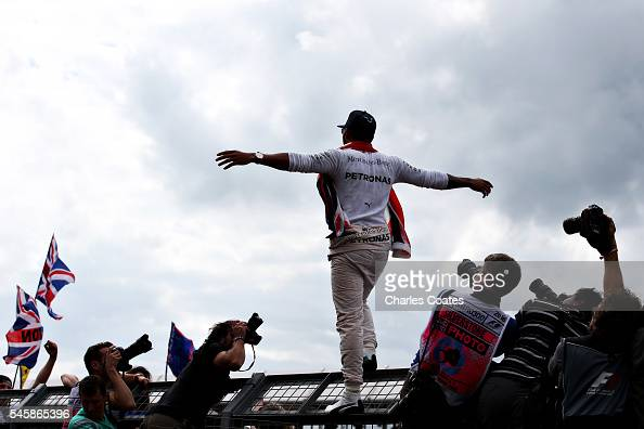 Lewis Hamilton of Great Britain and Mercedes GP celebrates his win with fans during the Formula One Grand Prix of Great Britain at Silverstone on...