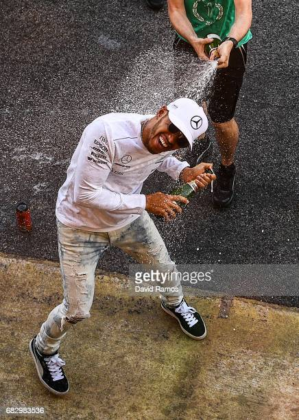 Lewis Hamilton of Great Britain and Mercedes GP celebrates his win with his team during the Spanish Formula One Grand Prix at Circuit de Catalunya on...