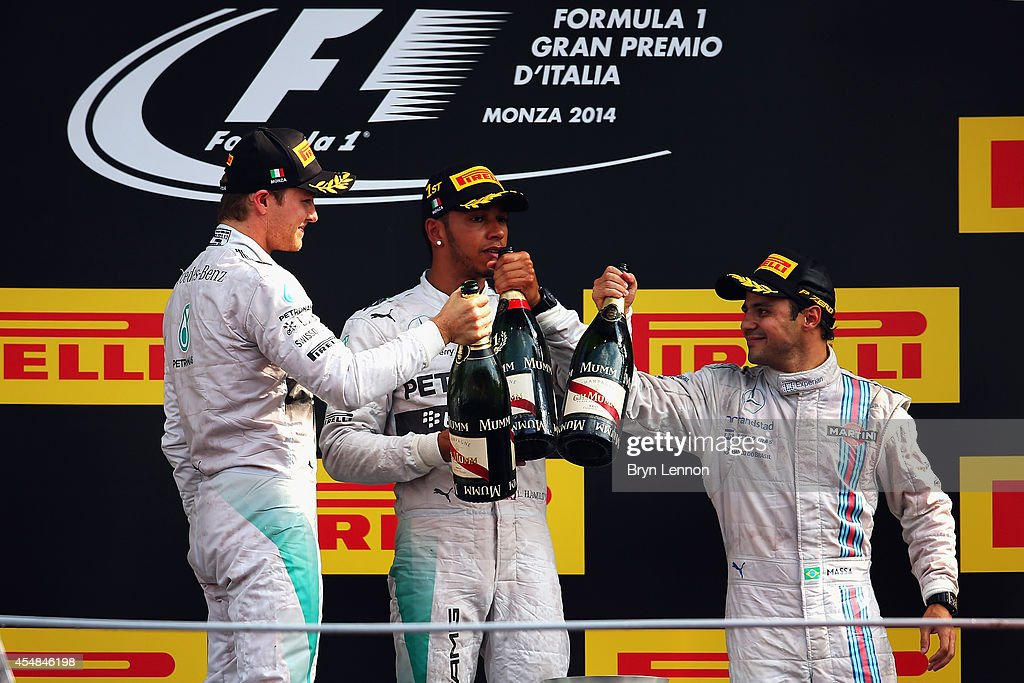 <a gi-track='captionPersonalityLinkClicked' href=/galleries/search?phrase=Lewis+Hamilton&family=editorial&specificpeople=586983 ng-click='$event.stopPropagation()'>Lewis Hamilton</a> (C) of Great Britain and Mercedes GP celebrates his victory with second placed <a gi-track='captionPersonalityLinkClicked' href=/galleries/search?phrase=Nico+Rosberg&family=editorial&specificpeople=800808 ng-click='$event.stopPropagation()'>Nico Rosberg</a> (L) of Germany and Mercedes GP and third placed <a gi-track='captionPersonalityLinkClicked' href=/galleries/search?phrase=Felipe+Massa&family=editorial&specificpeople=206660 ng-click='$event.stopPropagation()'>Felipe Massa</a> (R) of Brazil and Williams following the F1 Grand Prix of Italy at Autodromo di Monza on September 7, 2014 in Monza, Italy.