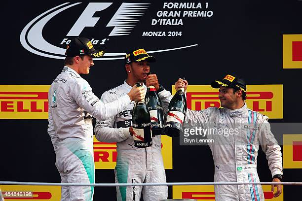 Lewis Hamilton of Great Britain and Mercedes GP celebrates his victory with second placed Nico Rosberg of Germany and Mercedes GP and third placed...