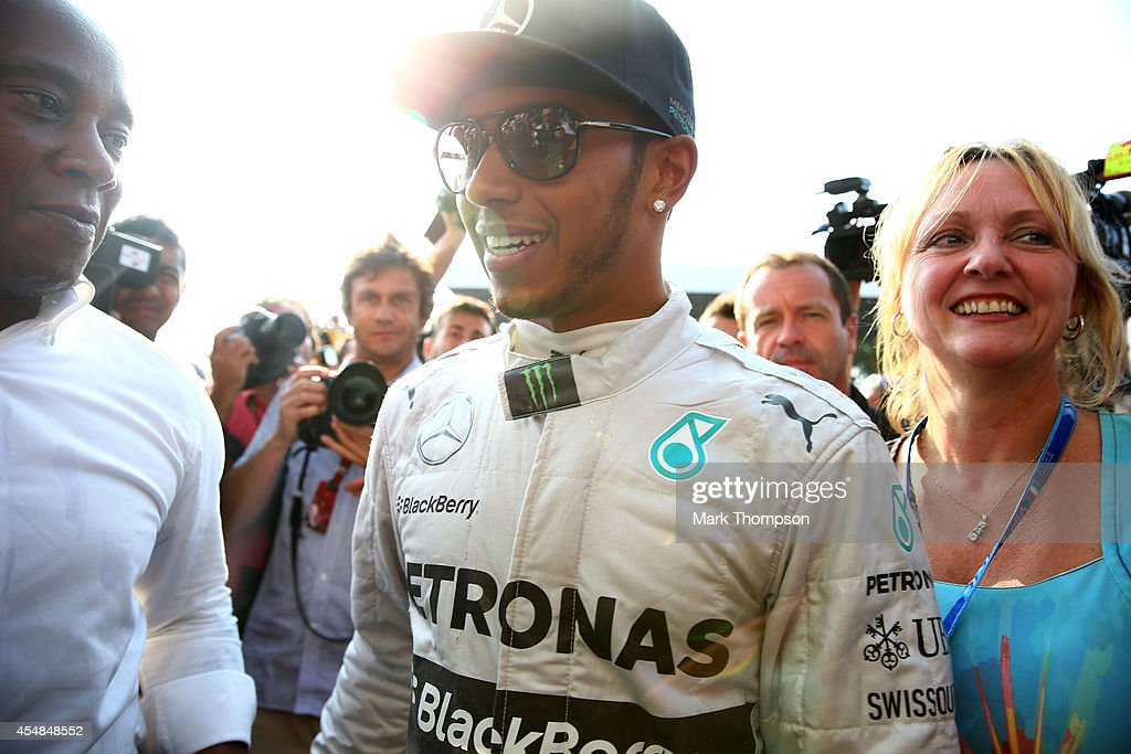Lewis Hamilton of Great Britain and Mercedes GP celebrates his victory with his father Anthony and his stepmother Linda during the F1 Grand Prix of...