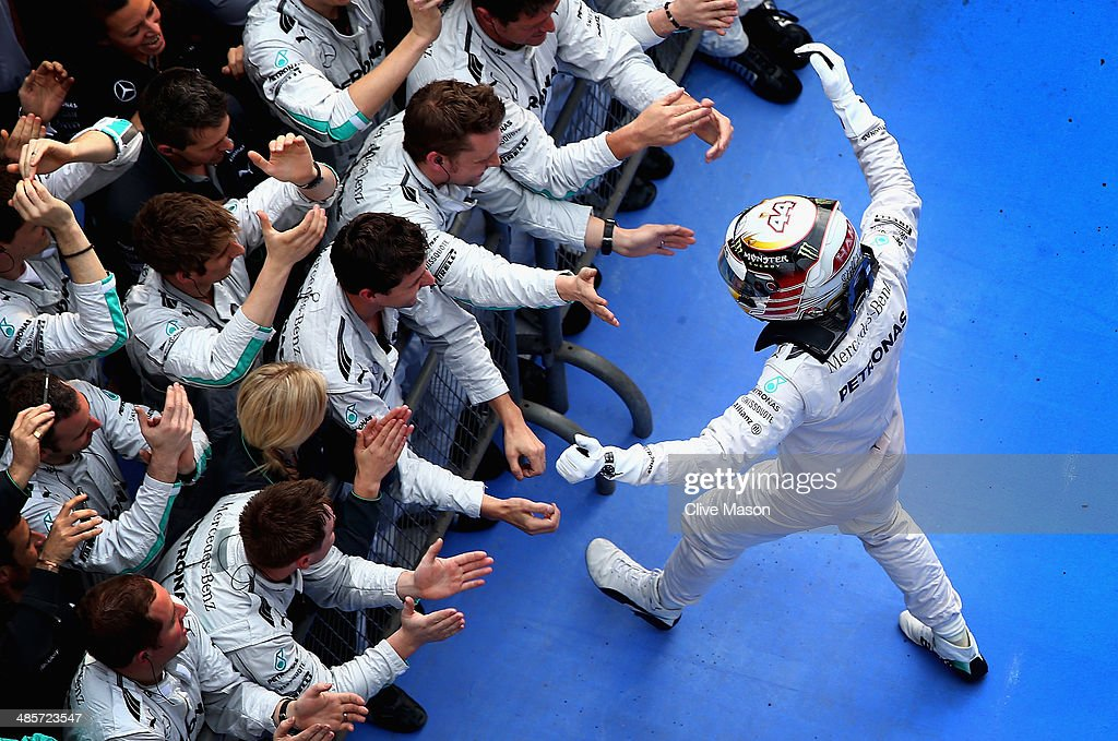 <a gi-track='captionPersonalityLinkClicked' href=/galleries/search?phrase=Lewis+Hamilton&family=editorial&specificpeople=586983 ng-click='$event.stopPropagation()'>Lewis Hamilton</a> of Great Britain and Mercedes GP celebrates his victory with his team following the Chinese Formula One Grand Prix at the Shanghai International Circuit on April 20, 2014 in Shanghai, China.