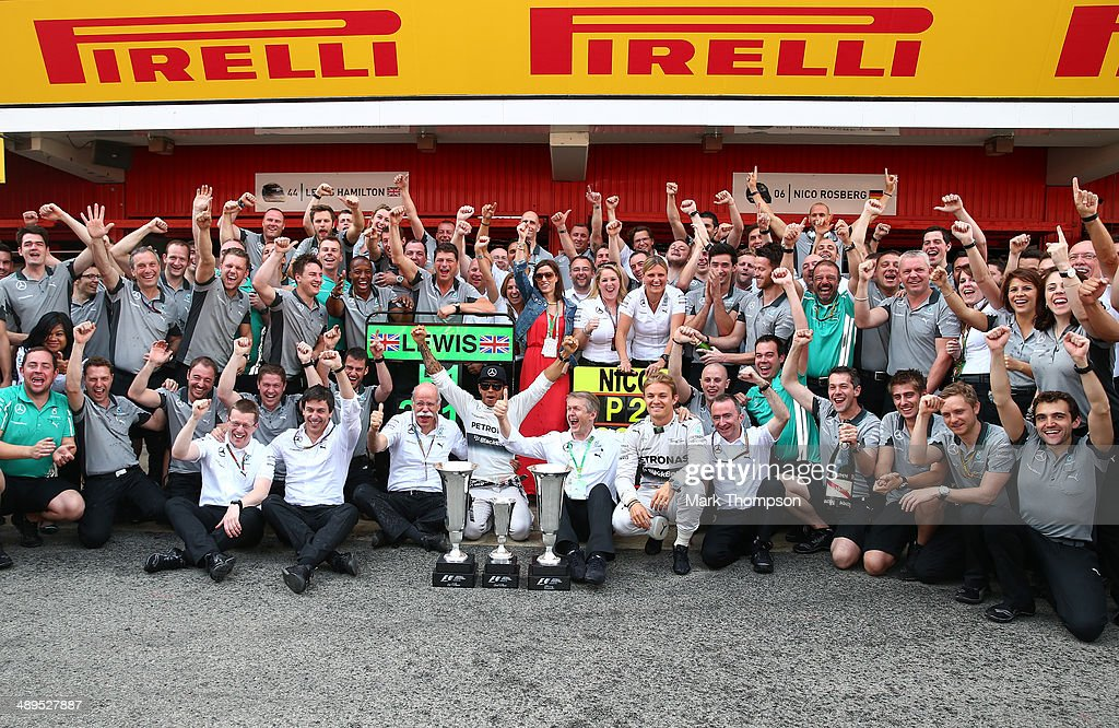 Lewis Hamilton of Great Britain and Mercedes GP celebrates his victory with Nico Rosberg of Germany and Mercedes GP and the rest of the Mercedes team after the Spanish Formula One Grand Prix at Circuit de Catalunya on May 11, 2014 in Montmelo, Spain.
