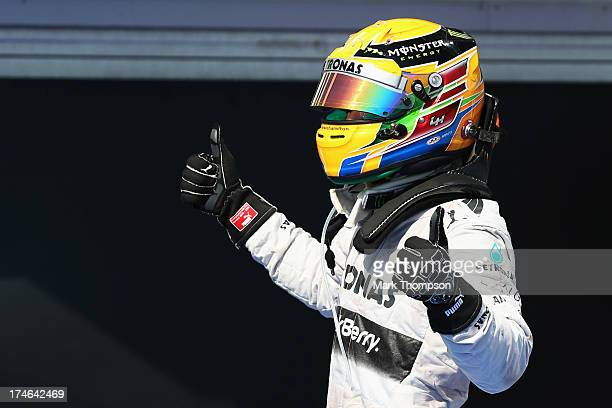 Lewis Hamilton of Great Britain and Mercedes GP celebrates in parc ferme after winning the Hungarian Formula One Grand Prix at Hungaroring on July 28...