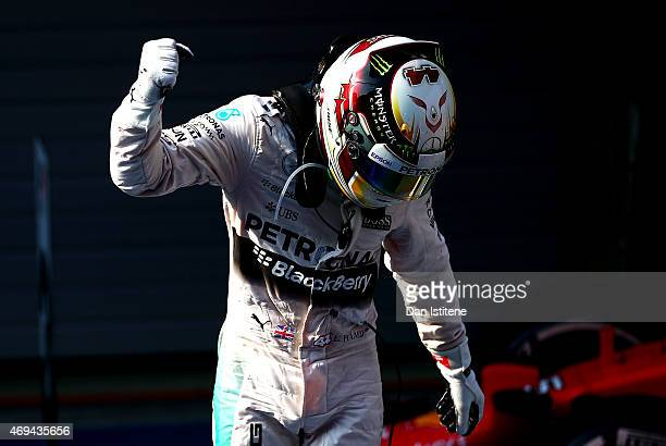 Lewis Hamilton of Great Britain and Mercedes GP celebrates in Parc Ferme after winning the Formula One Grand Prix of China at Shanghai International...