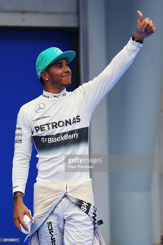 Lewis Hamilton of Great Britain and Mercedes GP celebrates in parc ferme after finishing first during qualifying for the Malaysia Formula One Grand Prix at the Sepang Circuit on March 29, 2014 in Kuala Lumpur, Malaysia.