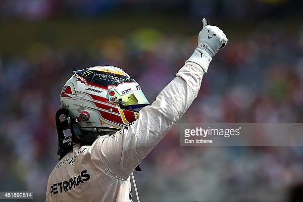 Lewis Hamilton of Great Britain and Mercedes GP celebrates in Parc Ferme after claiming pole position during qualifying for the Formula One Grand...