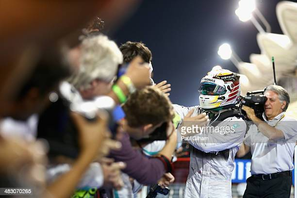 Lewis Hamilton of Great Britain and Mercedes GP celebrates in parc ferme after winning the Bahrain Formula One Grand Prix at the Bahrain...