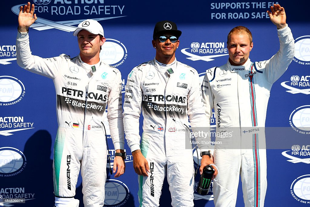 Lewis Hamilton of Great Britain and Mercedes GP celebrates in Parc Ferme next to Nico Rosberg of Germany and Mercedes GP and Valtteri Bottas of...