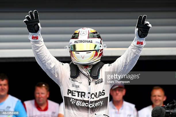 Lewis Hamilton of Great Britain and Mercedes GP celebrates in Parc Ferme after winning the Formula One Grand Prix of Belgium at Circuit de...