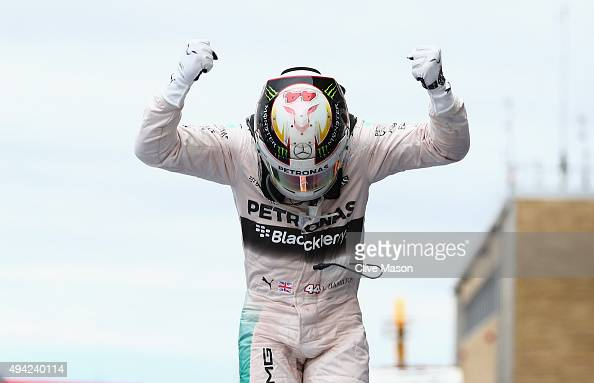 Lewis Hamilton of Great Britain and Mercedes GP celebrates in Parc Ferme after winning the United States Formula One Grand Prix and the championship...
