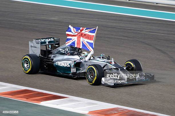 Lewis Hamilton of Great Britain and Mercedes GP celebrates in the car after winning the World Championship and the Abu Dhabi Formula One Grand Prix...
