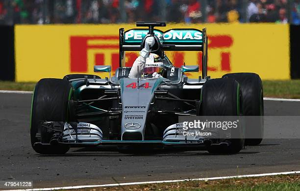 Lewis Hamilton of Great Britain and Mercedes GP celebrates in the car after winning the Formula One Grand Prix of Great Britain at Silverstone...